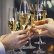 People holding glasses of champagne making a toast — Stock Photo #64451883