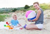 Happy family having fun at the beach — Stock Photo
