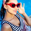 Beautiful pin up girl near the swimming pool — Stock Photo #64980209