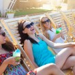 Girls with beverages on summer party near the pool — Stock Photo #65835109