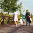 Happy family in golf country club — Stock Photo #65835125