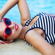 Beautiful pin up girl near the swimming pool — Stock Photo #65835175