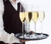 Professional male waiter in uniform serving champagne. DOF.  — Zdjęcie stockowe