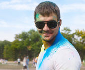 Happy young man on holi color festival — Stock Photo