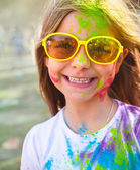 Happy cute litttle girl on holi color festival — Stock Photo