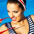 Beautiful pin up girl near the swimming pool — Stock Photo #66987143