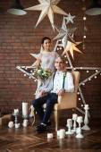 Cheerful couple near the brick wall decorated with the stars — Stock Photo