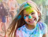 Portrait of happy litttle girl on holi color festival — Stock Photo