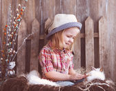 Portrait of an adorable baby girl and little white rabbit near t — Stock Photo