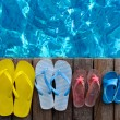 Brightly colored flip-flops on wooden background near the pool — Stockfoto #70652703