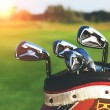 Golf clubs drivers over green field background — Stock Photo #70652825