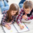 Two little kids drawing with crayons — Stock Photo #71821063