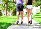 Rear view of caucasian female and male runners — Stock Photo