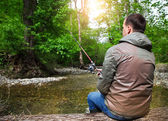Fisherman with fly-fishing on mountain river — Stock Photo