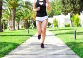 Runner feet running on road in the park. Woman fitness sunrise j — Stock Photo