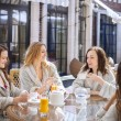 Four young women drinking tea at spa resort — Stock Photo #75735657