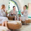 Three young women drinking tea at spa resort — Stock Photo #75893353