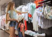 Mother and daughter shopping for clothes — Stock Photo
