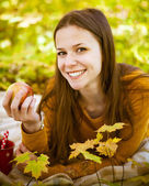 Portrait of a beautiful teenage girl having fun in autumn park — Stock Photo