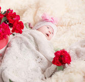 Baby with roses — Stock Photo
