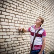 Teenager on background wall — Foto Stock