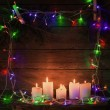 Christmas lights on a wooden background with copy space — Stock Photo #53425997