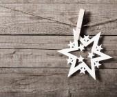 Snowflakes border on grunge wooden background — Stock Photo