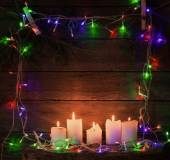 Christmas lights on a wooden background with copy space — Stock Photo