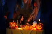 Two witch with pumpkin lantern at home — Stock Photo