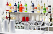 Front bar with glasses and shaker — Stock Photo