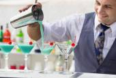 Barman pouring a cocktail drink — Stock Photo