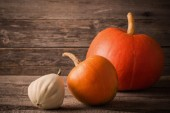 Pumpkins on wooden background — Stock Photo