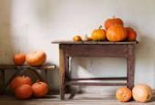 Pumpkins in old rustic room — Stock Photo