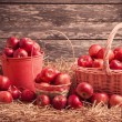 Red apples on wooden background — Stock Photo #53907571