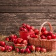 Red apples on wooden background — Stock Photo #53907733