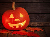 Pumpkin head on wooden background with copy space — Stock Photo
