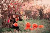 Happy girl in halloween costume with jack pumpkin — Stock Photo