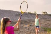 Two girls playing badminton outdoor — Stock Photo