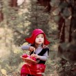 Little Red Riding Hood in the woods — Stock Photo #56968001