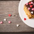 Cake with hearts on wooden background — Stock Photo #56970587