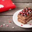 Cake with hearts on wooden background — Stock Photo #56970763