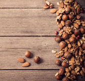 Mixed nuts on old wooden background — Stock Photo