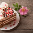 Cake with hearts on wooden background — Stock Photo #60575753