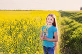 Smile girl in rape field — Stock Photo