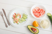 Cooked shrimps with avocado and mozzarella on white wooden table — Stock Photo