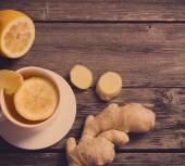 Ginger tea with lemon in a white cup — Stock Photo