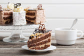 Cup of coffee and cake on old wooden table — Stock Photo