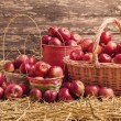 Red apples on wooden background — Stock Photo #65790517