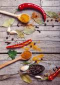Colorful spices on a wooden background — Stock Photo