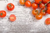 Cherry tomatoes on rustic wooden background — Stock Photo